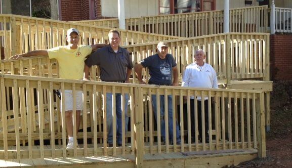 A 95-foot wheelchair ramp was installed for a World War II veteran. From left: Randy Lahr, Marine Corps League of Woodstock; Gary Gailey of Woodstock Post 316; Charles Barnes, Soleil Veterans Club of Canton; and Mike Satterly, American Legion Post 316 Woodstock.