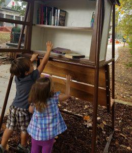 Ethan and Elliott Tate help stock the shelves.
