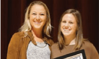 River Ridge alumna Shannon Driscoll, left, presented the Courageous Athlete Award to Zia Yurchuck