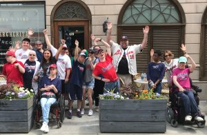 Special-needs clients and staff of  Next Step Ministries enjoying a Braves game through Experiences before the pandemic.